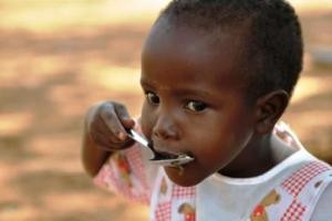 african-child-eating-from-childfund-dot-org-dot-nz