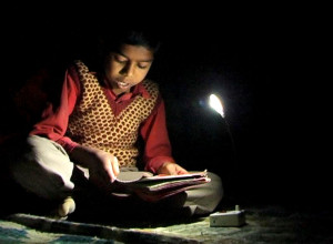 boy-studying-with-solar-LED-light